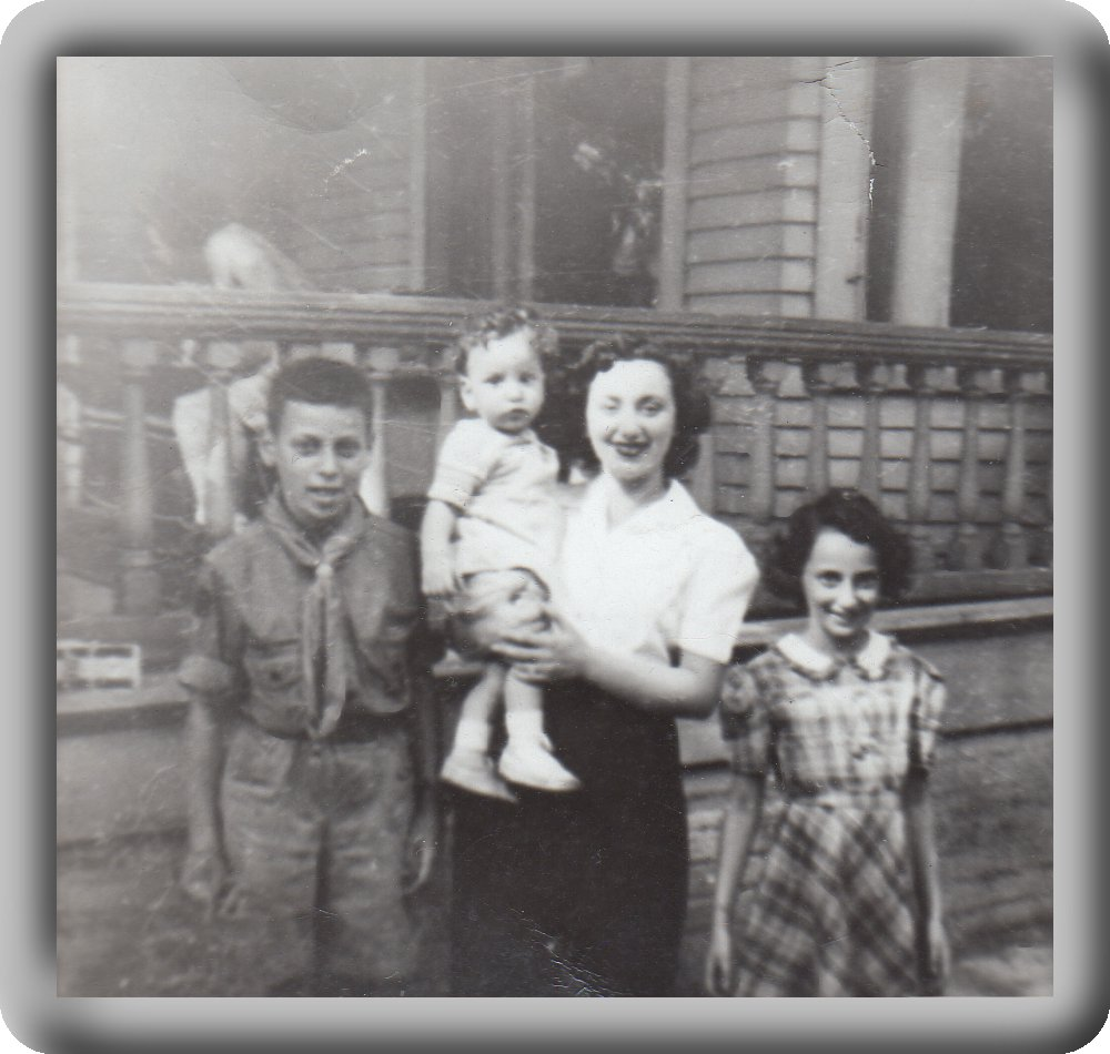 Boyscout Frank (brother), Helen (sister) holding Chuckie, Jeane (sister)